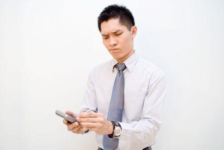 visualizing: Asian male business serious using PDA