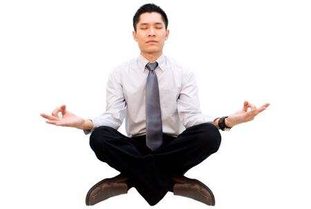 man meditating: Asian business male in meditation pose