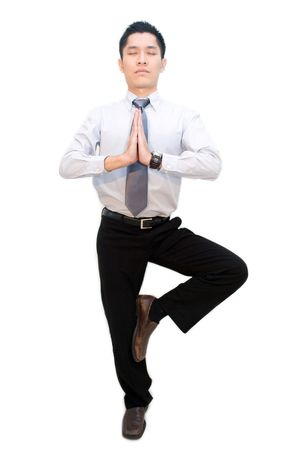 Asian business male in standing meditation pose Stock Photo