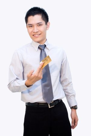 Asian business guy showing gold credit card Stock Photo - 4973557