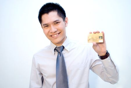 Asian business guy showing gold credit card Stock Photo