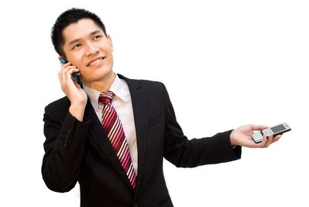 office force: Asian business guy talking on phone Stock Photo