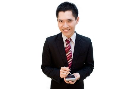 Asian male in suit using PDA photo
