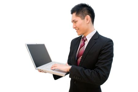 Asian business male using laptop Stock Photo - 4969823