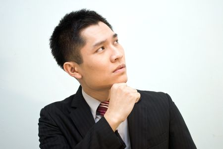 office force: Asian business man looking at top thinking