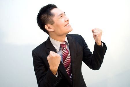 Confident Asian Business man looking upwards