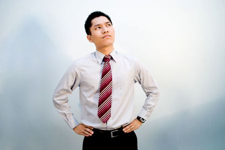 envisage: Asian male business looking upwards thinking