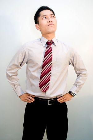 slack: Asian male business looking upwards thinking
