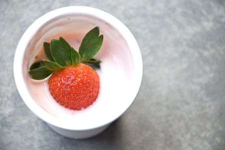 Strawberry in yogurt cup