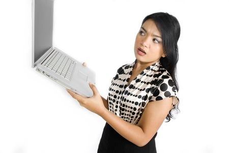 Female asian business woman curious looking at laptop photo