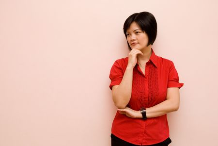 envisage: Asian lady thinking - stand position Stock Photo