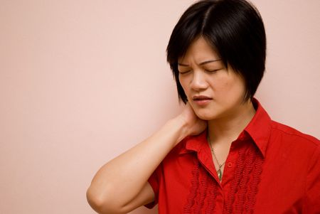 Asian lady with neckache photo