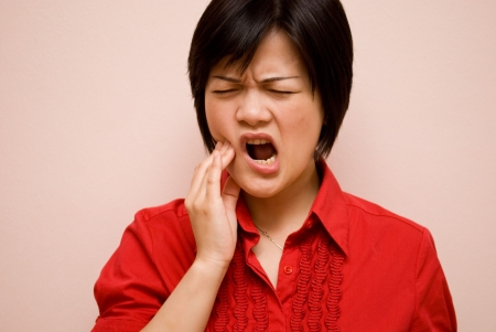 Asian lady with tooth pain