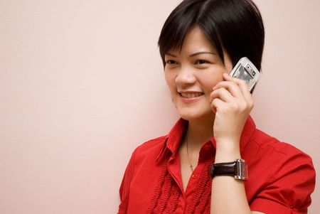 Asian lady pn mobile phone Stock Photo - 5394846
