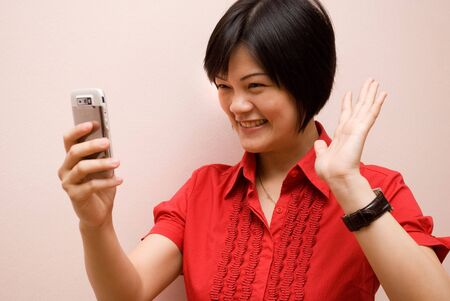 Asian lady waving and video calling photo