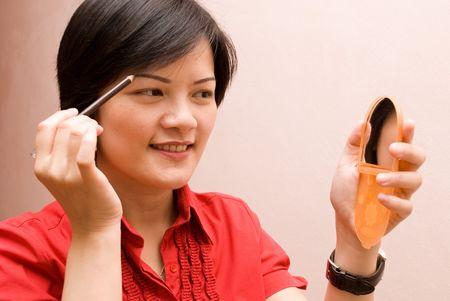 brow: Makeup - darkening the brow Stock Photo