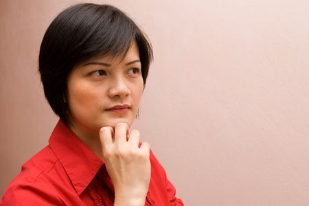 Asian lady thinking side profile photo