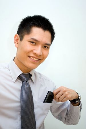 Asian guy posing with handphone in the pocket photo