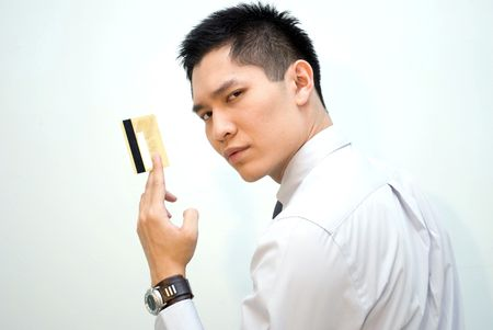 Asian business guy showing gold credit card photo
