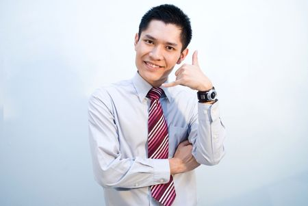 Asian business guy with phone sign photo