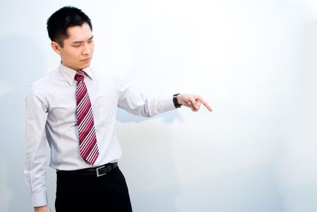 Asian business guy pointing down photo