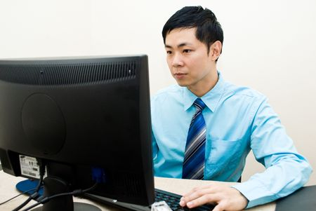 Asian business guy serious pose Stock Photo