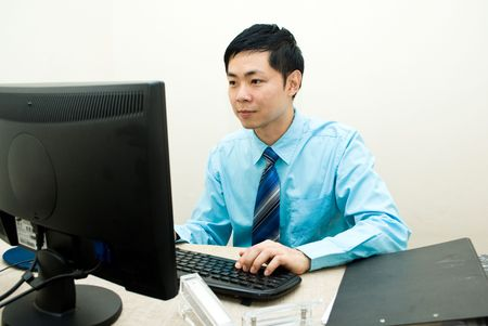 Asian business male serious working photo