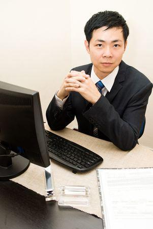Asian business man at desk - serious photo