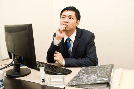 office force: Asian businesman thinking Stock Photo