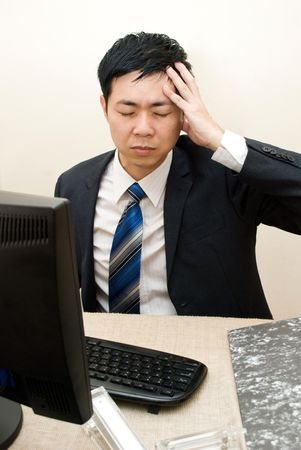 Asian businessman headache photo