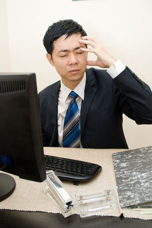 Asian businessman headache Stock Photo