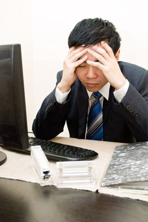 office force: Asian business man headache while working