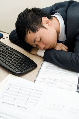 overwhelm: Asian man asleep on the job