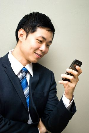 Asian business man reading sms or video call photo