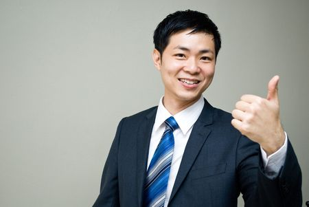 advancement: Asian business man cheerful - good sign