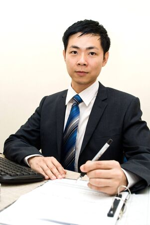 Asian businessman posing with work photo
