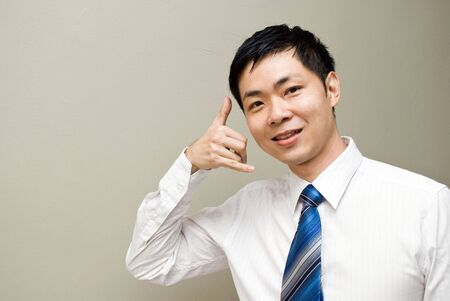 Asian contact us- friendly asian businessman photo