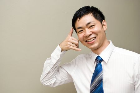 office force: Asian contact us- friendly asian businessman Stock Photo