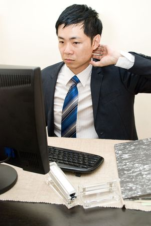 Asian businesman tired of working - neck ache Stock Photo