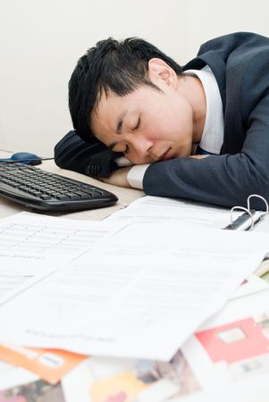 office force: Asian man asleep on the job