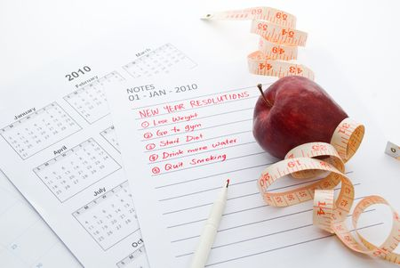 resolutions: New Year Resolution diet - apple and measuring tape