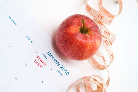 New Year Resolution diet - apple and measuring tape photo