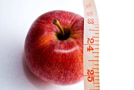 Apple with measuring tape - 24inch Stock Photo - 5770101