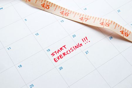 Start Exercising - note on measurement and calender Stock Photo