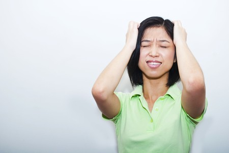 Asian female headache pose Stock Photo - 7967836