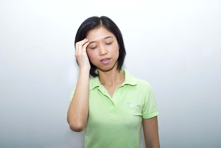 Asian female headache pose photo
