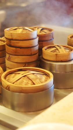 Rows of dim sum container in steamer - kitchen setup