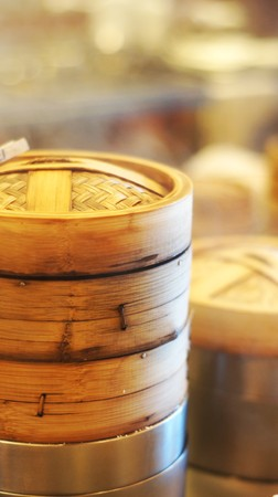 Rows of dim sum container in steamer - kitchen setup             Stock Photo