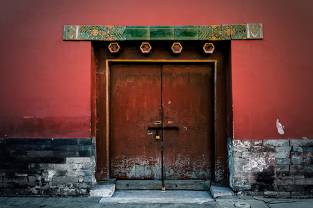 Door at the Forbidden City, Was the Chinese Imperial Palace from the Ming Dynasty to the end of the Qing dynasty. Beijing, China Photo taken on 2nd December 2015
