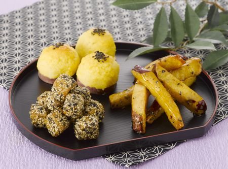 Traditional Japanese sweets on the traditional tray photo